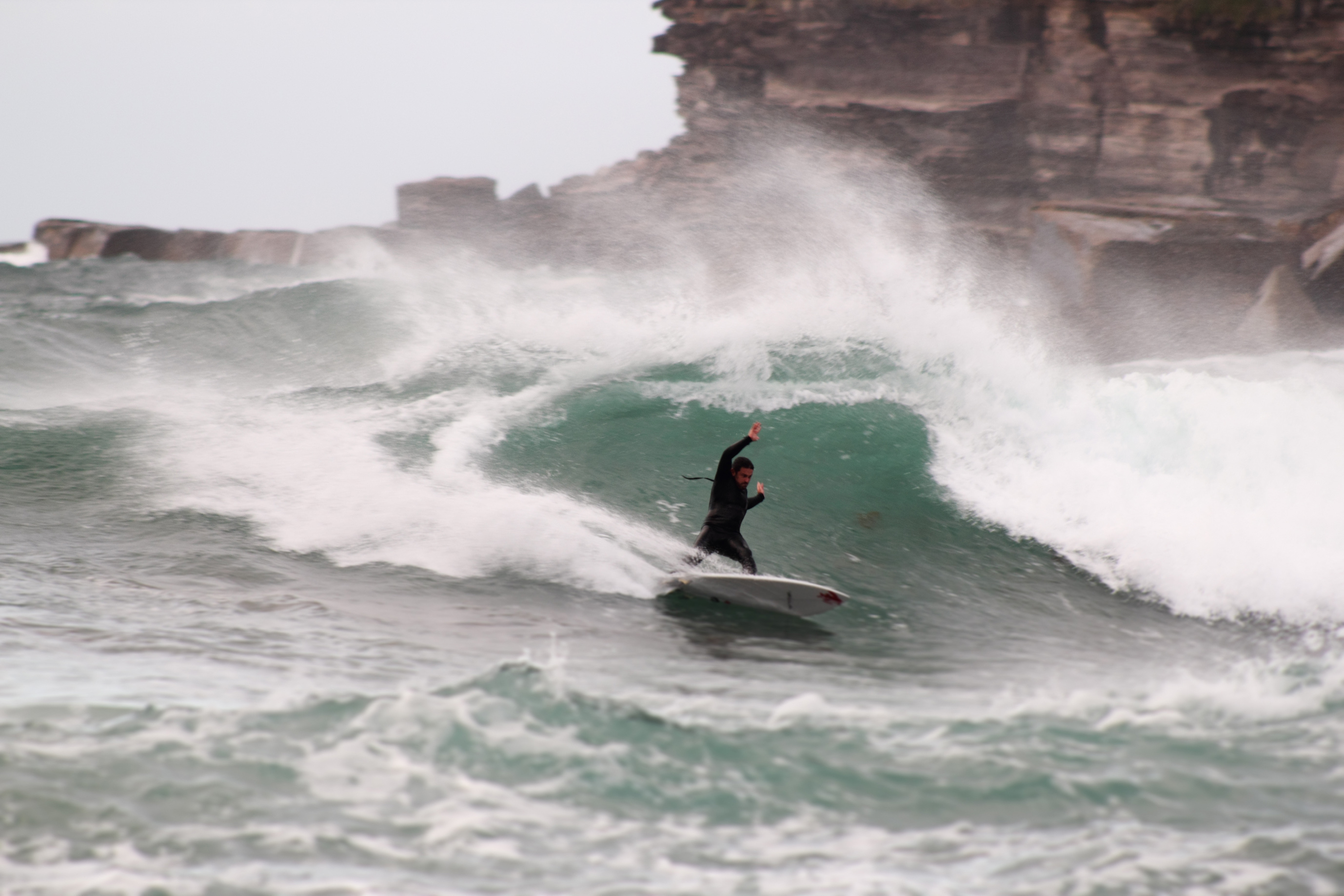 Nathan cutting back on a crisp wall. Photo: Mike Brown