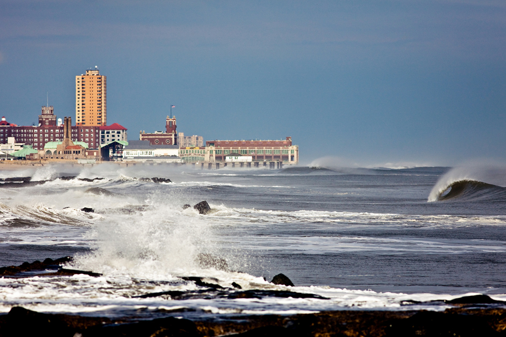 Another empty wave with historic Asbury Park in the background. Also seen is the Ocean Grove pier, no longer there as it fell to Hurricane Sandy last year.