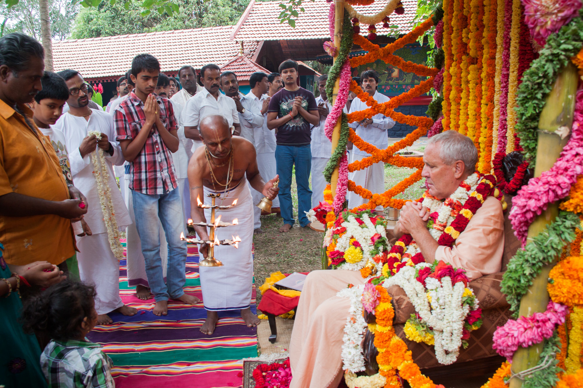 The guru accepting offerings from his disciples. Photo: