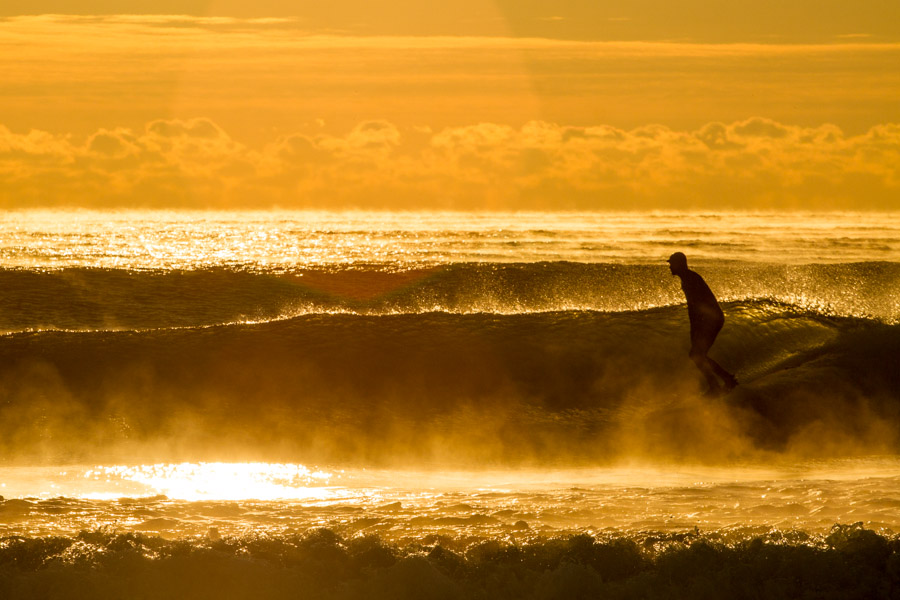 Surrounded by sea smoke, Erik Schmidt catches a rare right hander. Photo: Christor Lukasiewicz