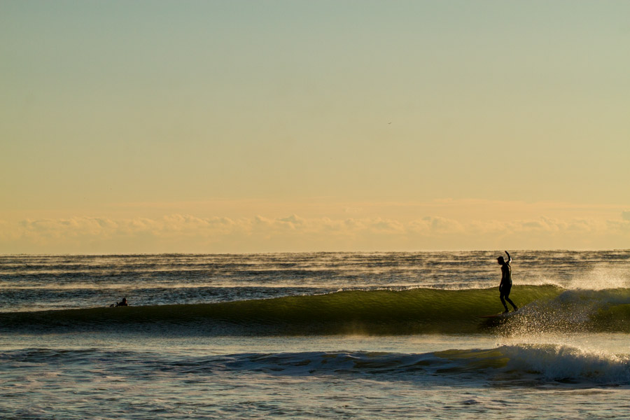 By this time my feet were frozen. Waving goodbye on my last wave. Photo: Christor Lukasiewicz