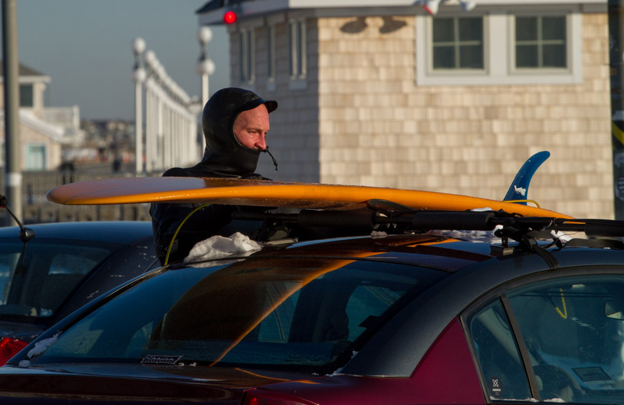 Hustling to get my board strapped and be on  my way. My facial expression is a good indicator of how cold it was. Photo: Christor Lukasiewicz