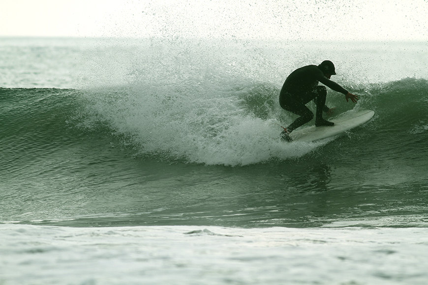 "Jesse sliding the tail on a 5'1"" ASQ by Manny. Photo: M. Caro"