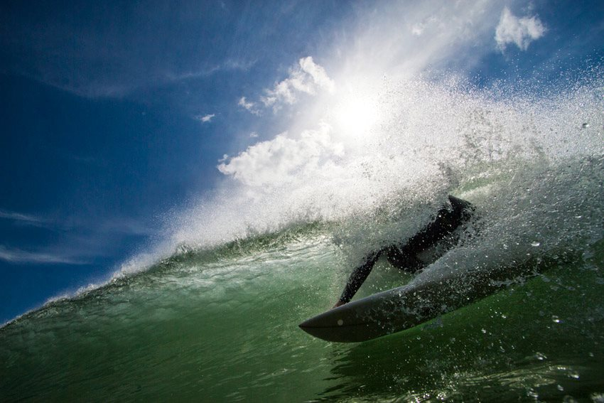 Fully enjoying the unique feeling of the single fin sliding under the cresting lip.