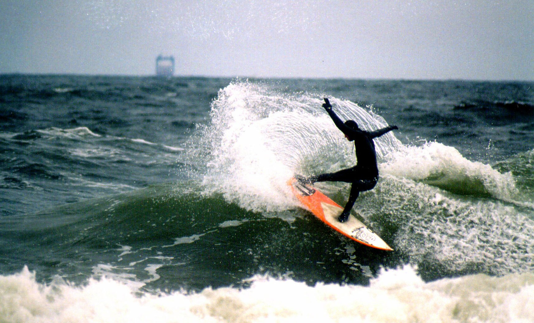"""Riding a """"shortboard"""" in 2002. Even then I went with shapes that had less rocker and a bit more volume, as I felt they worked better in the conditions I was normally surfing. Photo: Donna Zappo"""